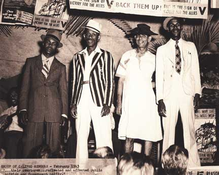 Invader, Growler, Atilla (in dress) and Lion in a calypso tent in 1943